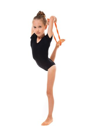 girl doing gymnastics in a sports swimsuit on a white background with copy space.