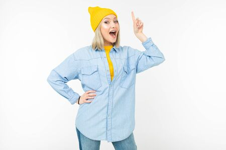 blond joyful girl shows thumb up on a white background isolated.