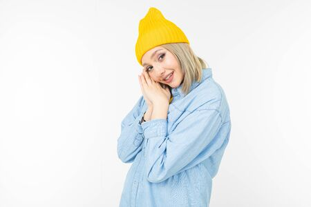 close-up of a charming blond girl in a blue denim jacket on a white background isolated with copy space. 版權商用圖片