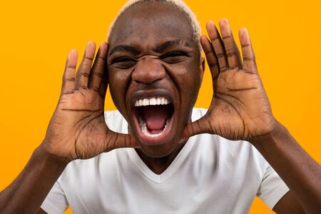 young black african man screaming loudly. Stock Photo