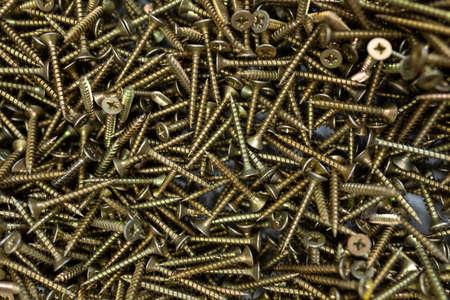 pile of screws close up, hardware store. Фото со стока