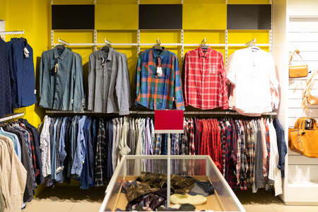 clothing store with a large assortment of shirts.