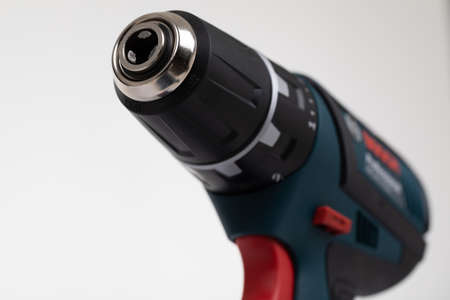 cordless electric drill close-up on a white background.