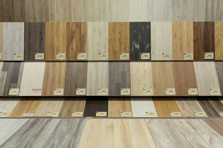MINSK, BELARUS - April 01, 2020: a large assortment on the shelves of the store with samples of parquet for the house.
