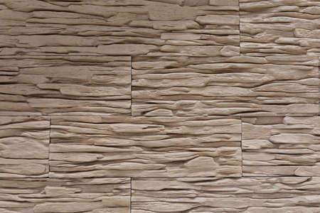 brown plasterboard wall closeup.