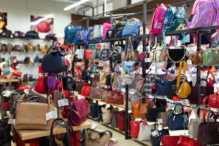haberdashery store with women's handbags on display cases.