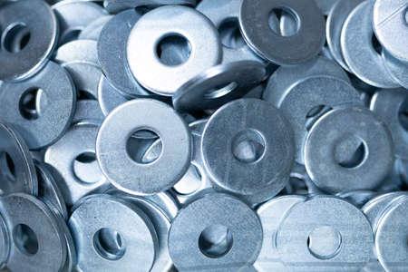 closeup construction parts: nuts and rings.