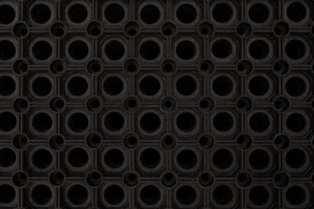 black rubber floor mat close-up.