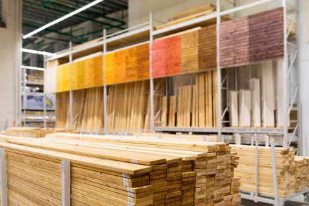 hardware store: shelving with large wooden boards. Foto de archivo
