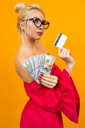 girl in a red dress with a win of money and a meditation card with a layout Stock Photo