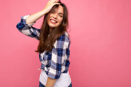Portrait of positive cheerful fashionable woman in hipster outfit isolated on pink background with copy space. 写真素材