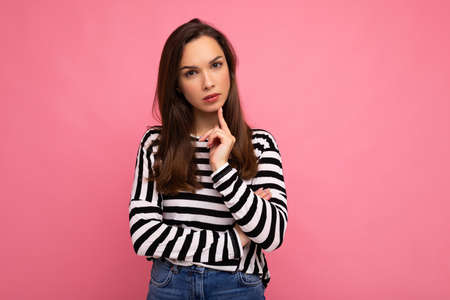 Closeup photo of amazing thoughtful beautiful young woman deep thinking creative female person holding arm on chin wearing stylish outfit isolated on colorful background with copy space.