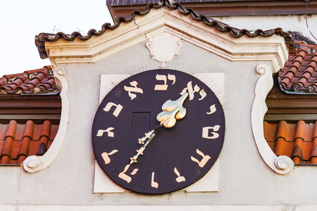 Hebrew Clock on Old Jewish Town Hall in Prague Stock Photo