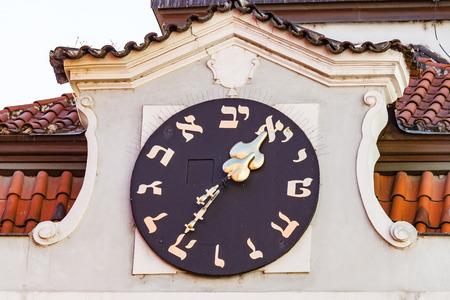 jewish: Hebrew Clock on Old Jewish Town Hall in Prague Stock Photo