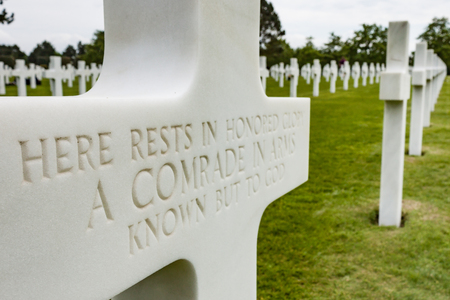 a memorial to fallen soldiers: Rows of White Crosses at Allied Grave Site in Normandy