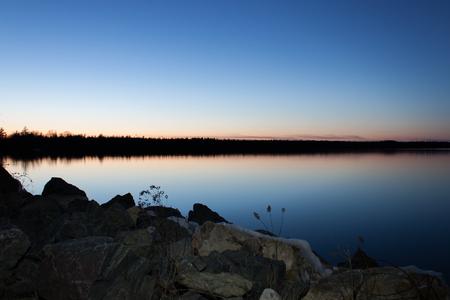 skie: Sunset Lake with Deep Blue Sky Stock Photo