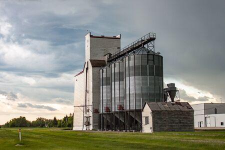Prairie Grain Elevator Against Stormy Sky