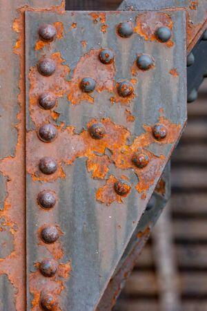 rivets: Detail image of rusty rivets on a railway bridge
