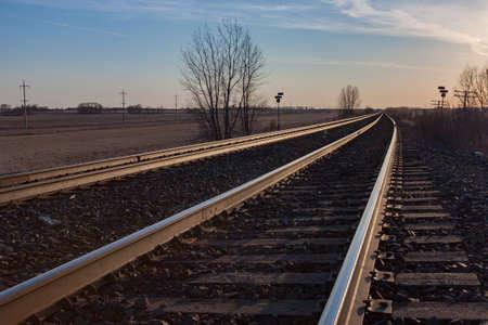 sun lit: Sun lit tracks heading toward horizon at sunset