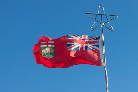 winnipeg: Manitoba provincial flag on flagpole with star top