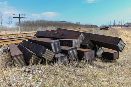 wood railroad: A pile of new ties wait to be installed under the nearby track