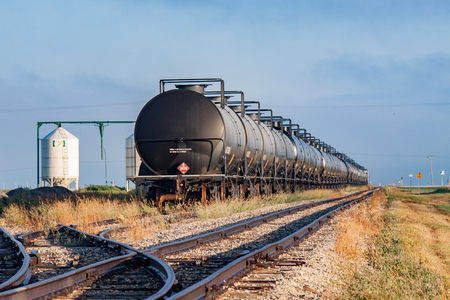 Railway tank cars rest in a siding in storage. Stock Photo