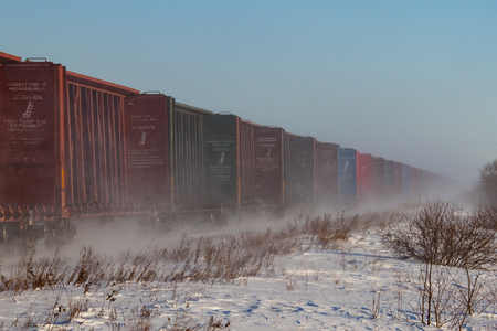 flatcar: A line of empty lumber railway cars wagons in the winter