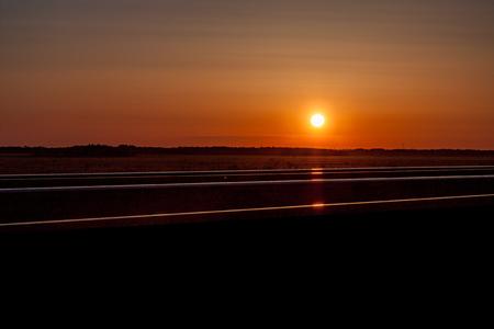 Golden Prairie Sunset Over Train Tracks