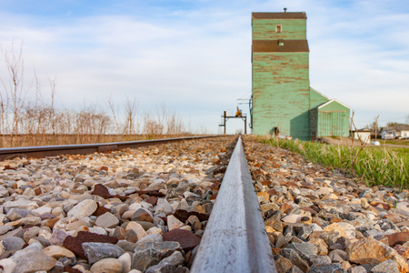 Steel Rails Leading to Old Wooden Grain Elevator Stock Photo - 82161465
