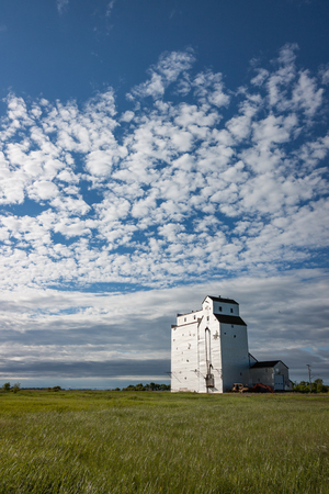 Vertical Crop of Wooden Grain Elevator Under Gorgeous Blue Sky Stock Photo