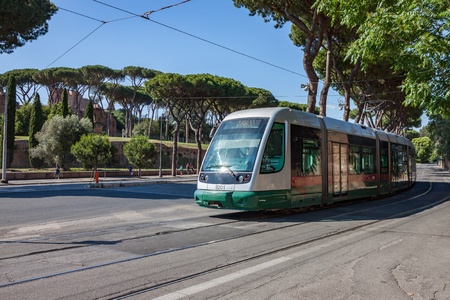 A modern electric streetcar passing through Rome near the Colosseum Stock Photo - 85895393