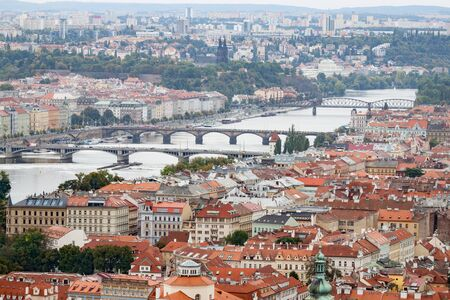 View of Prague's Red Roofed Buildings and Bridges over the Vltava River