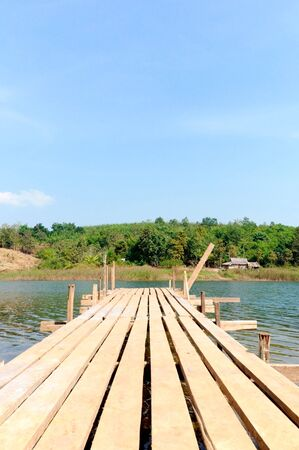 Old Wooden pier in the summer time photo