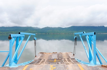 Blue ferryboat go to the land photo