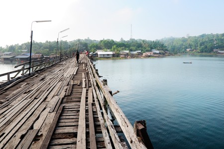 The old wooden bridge on reservoir,Kanchanaburi Thailand photo