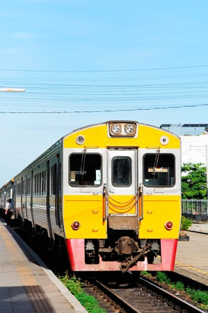The diesel railcar on platfrom of Nakronpratom Station photo