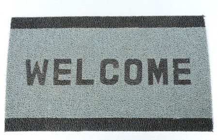 Welcom doormat placed near the entrance Stock Photo