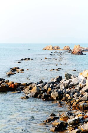 Rocky coast in the early morning,Thailand photo