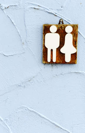 Wooden toilet sign on the bule wall photo