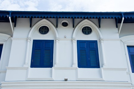 Blue window on the white European building photo