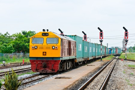 goods train: Cargo train running into railway yard of Chachoengsao  junction,Thailand