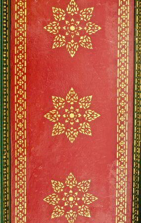 Golden flower pattern on the ceiling of Thai pavilion photo