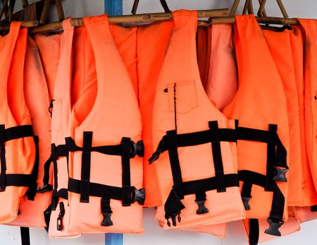 security vest: Orange life jackets Stock Photo