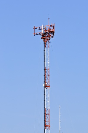 Phone antenna pole on the roof of building Stock Photo - 8289842
