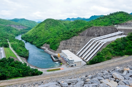 Large electric power dam in valley of western Thailand photo