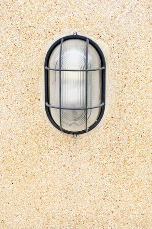 Modern lantern on the sand wall of university photo