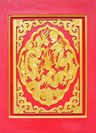 Golden dragon statue on the red wall of Chinese temple photo