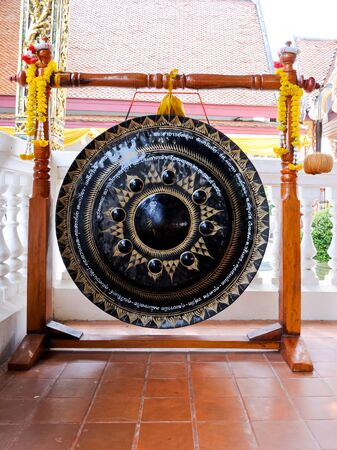 Traditional Thai gong in front of church inside the temple. photo