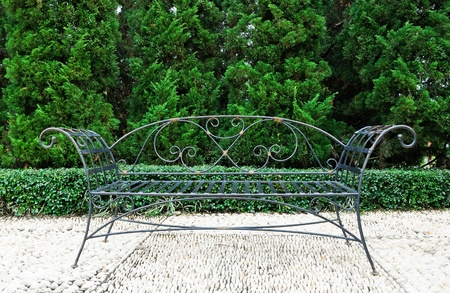 Classic style of black metal sofa in the Spanish garden.