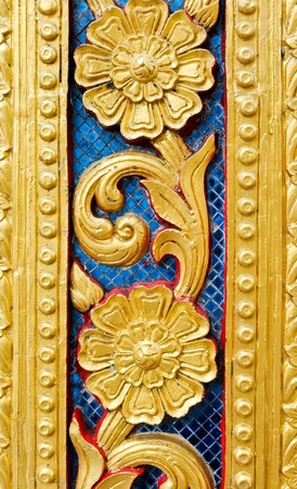 Golden patterne of carvings on wood inside the royal temple,Thailand. Stock Photo - 9340756